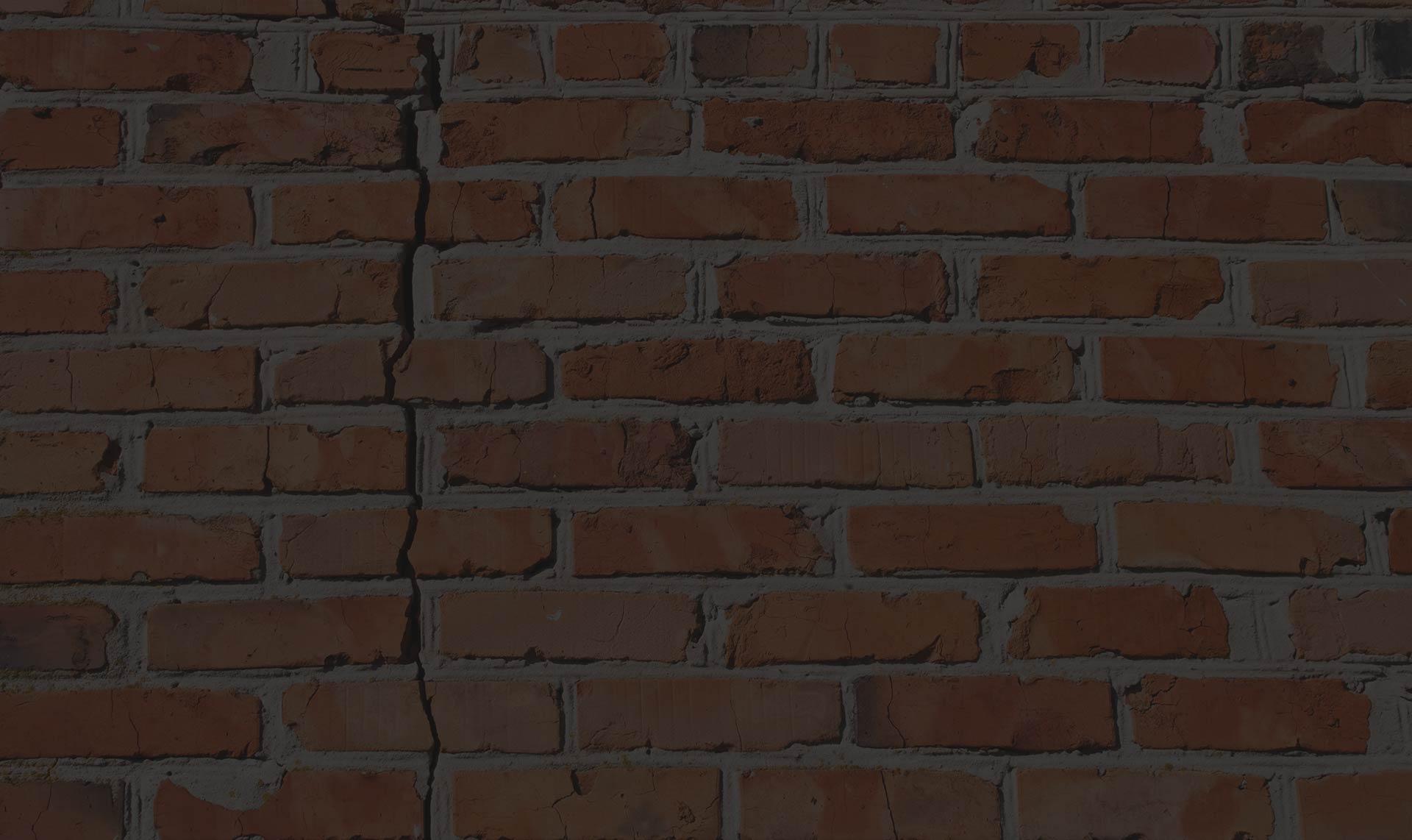 cracked brick wall image