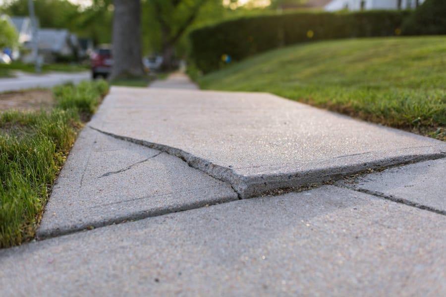 Concrete repair necessary on sidewalk