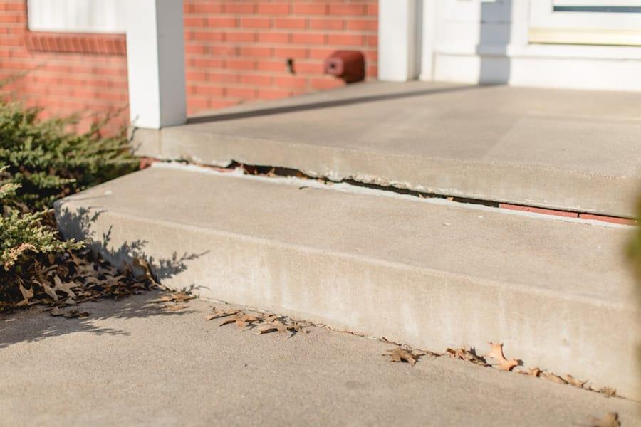 Porch crack sign of foundation settlement