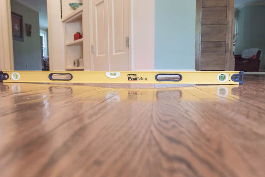 Measuring sagging wood floors in home