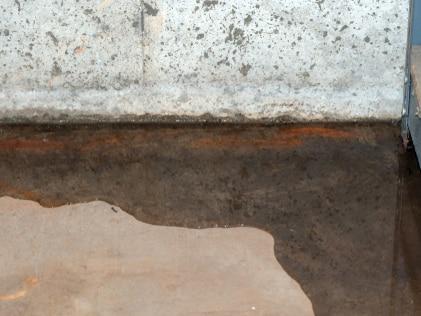 Water leaking in basement corner