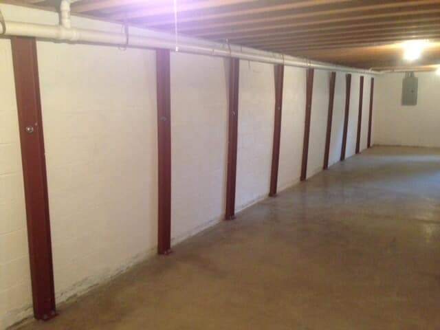 Bowed walls repaired with anchors