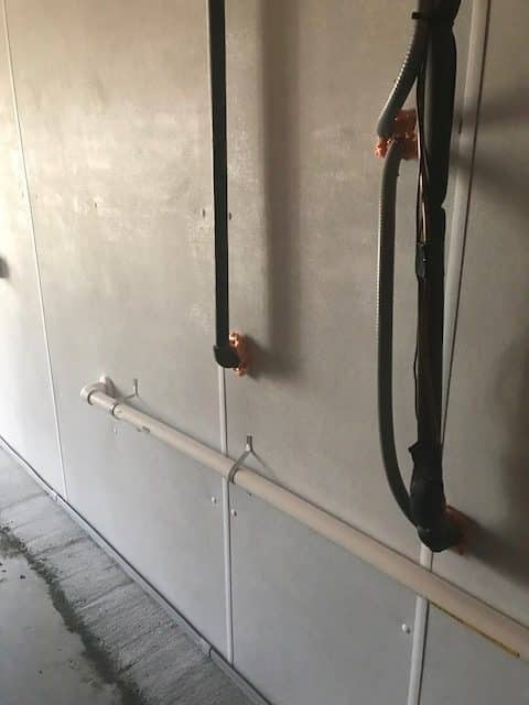 New basement wall panels with pipes