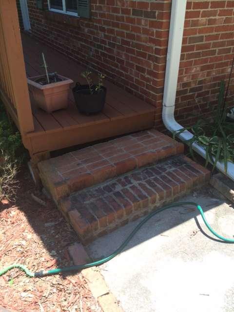 Brick steps gap to wood deck