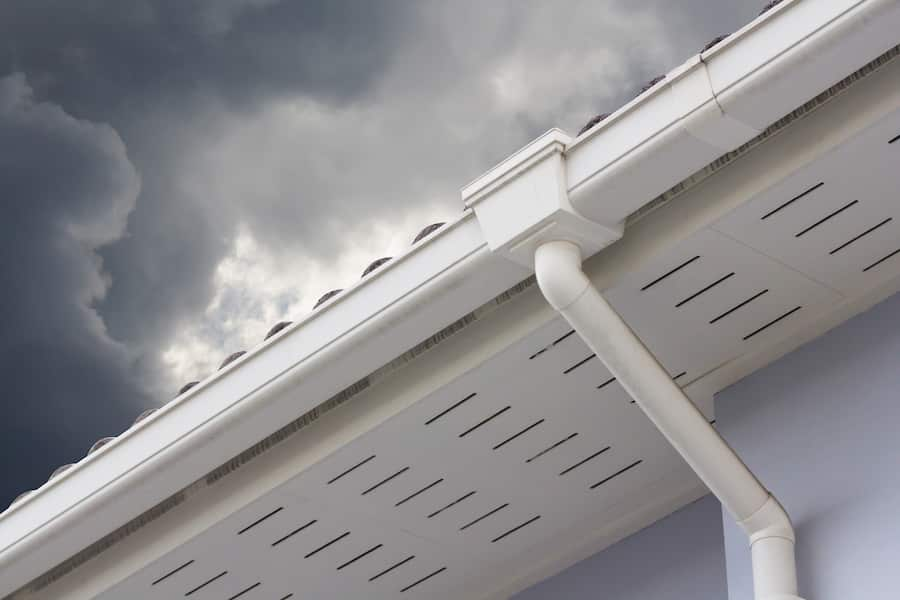 Gutters on home in front of gray sky